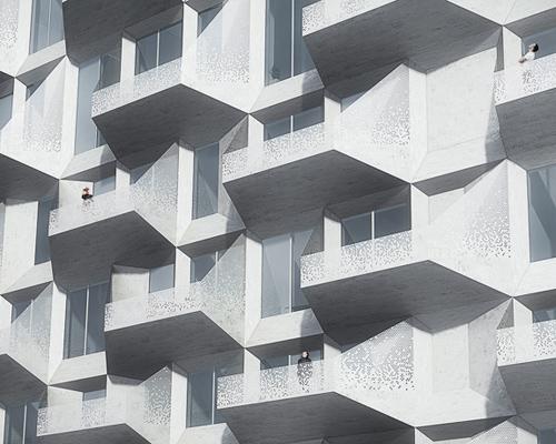 COBE建筑公司在哥本哈根市 Nordhavnen 工业区将一座粮仓改建为内部设有公共设施的居民住宅大楼