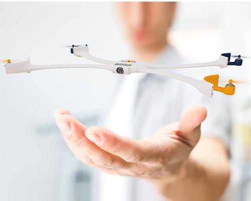 静是戴在手腕上的一款时尚手表,动是在空中飞舞拍摄动感照片的一架四旋翼无人机