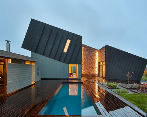 snøhetta 建筑师事务所完成挪威倾斜的零排放试验性住宅