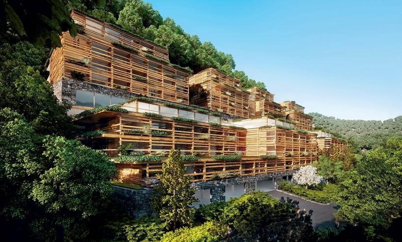"""由建筑学院翻译 图片由matteo thun and partners提供 该项目位于瑞士布尔根施托克,米兰事务所的Matteo Thun和他的同事将可持续性,自然环境,创新技术结合在一起,设计了这个""""瓦尔德健康生活酒店""""。该酒店将提供保健设备以及一些不同种类的医疗服务。建筑主体嵌入山中,在外立面设计上参考了当地的Walser建筑,用连续的木质格子结构将建筑主体完全包裹——而建筑主体则是用当地石材制成。  这个综合性酒店将提供保健设施以及一些不同种类的医疗服"""