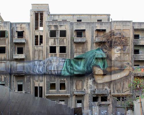 gerada在战后建筑上创作代表希望的巨幅壁画